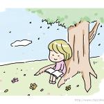 草原で本を読む女の子
